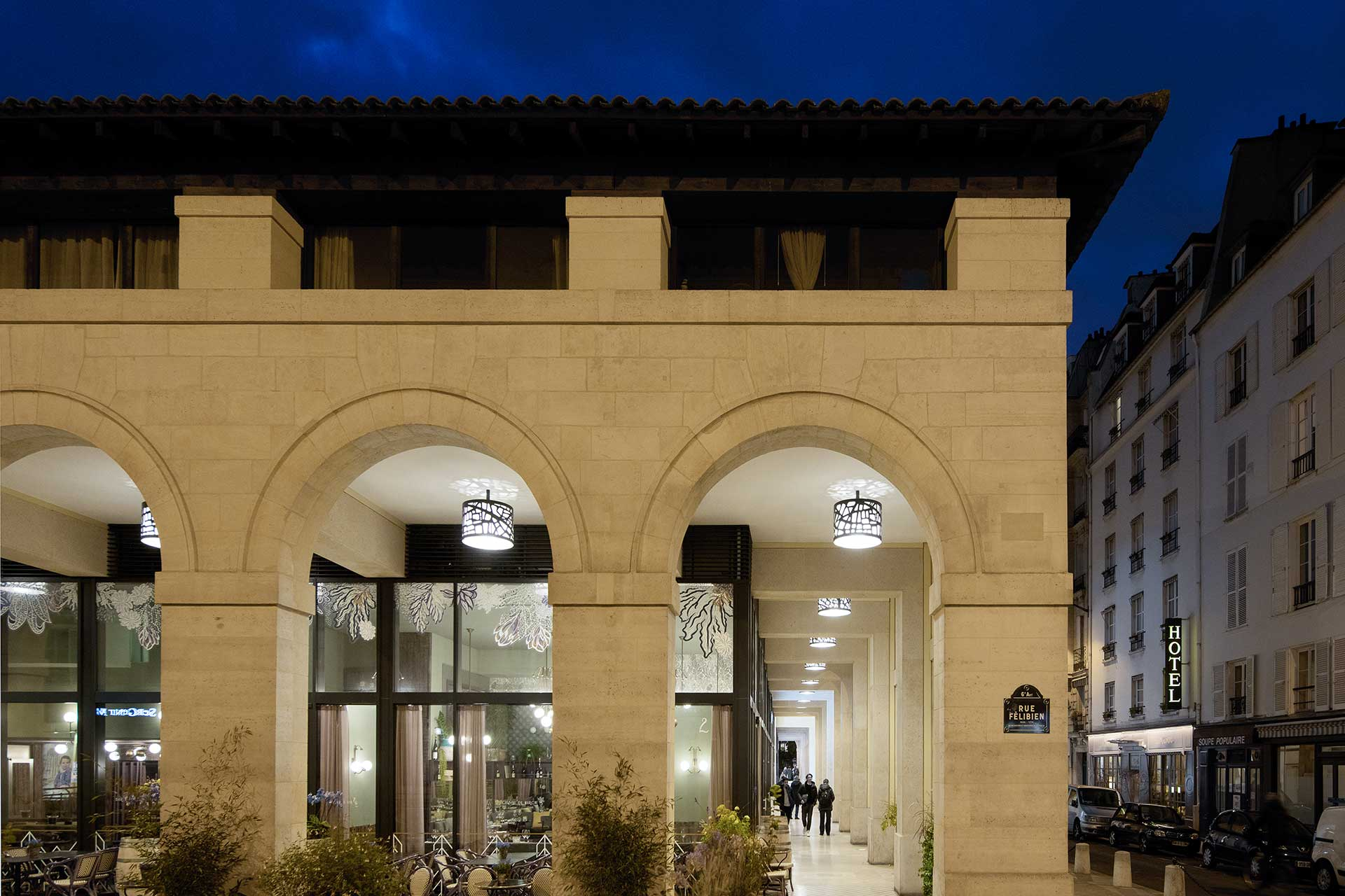Customised luminares have transformed the nocturnal appearance of Marché Saint Germain while cutting energy costs