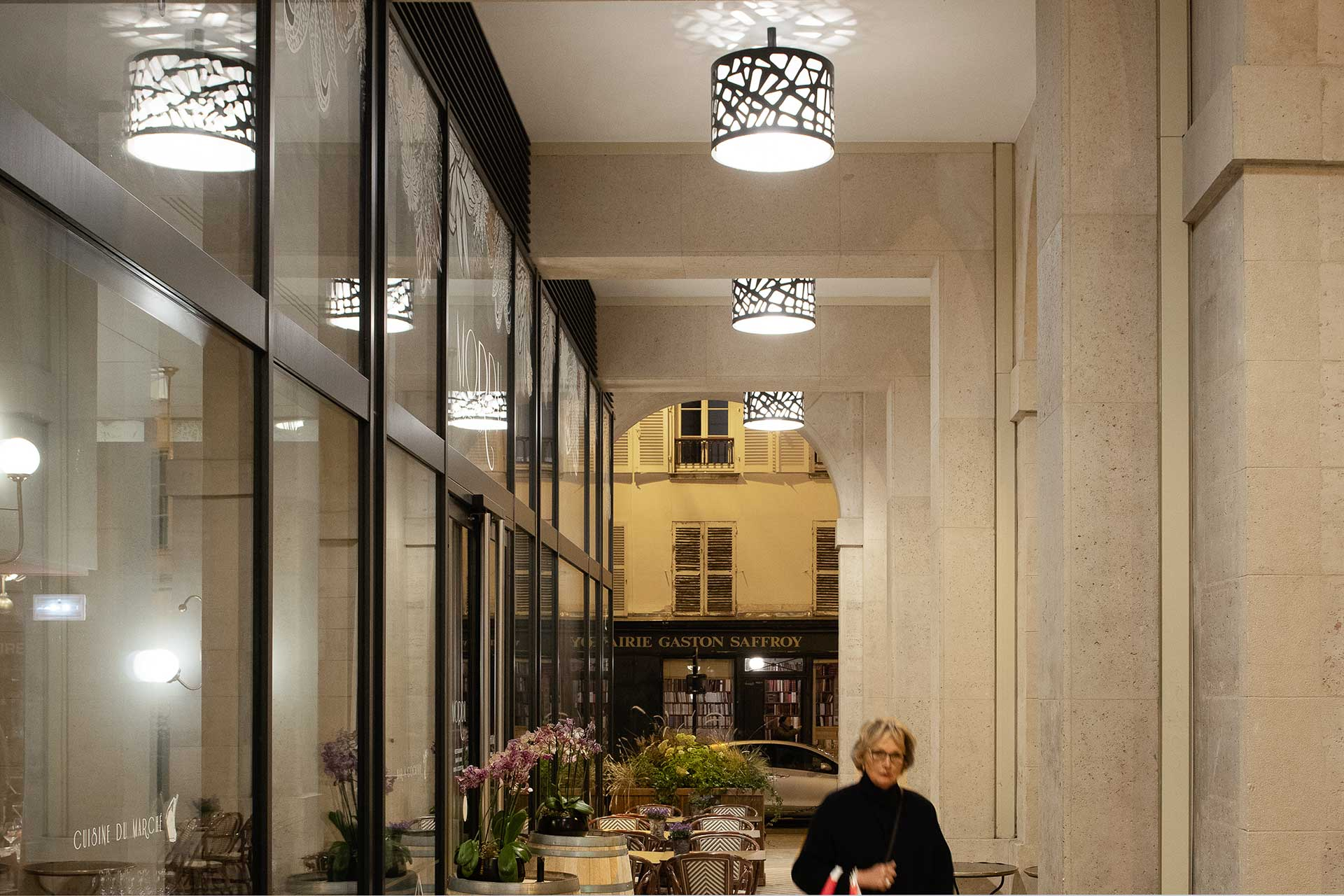 Bespoke luminaires delivering an average of 35 lux for arcades in Marche Saint Germain to create safe and inviting space that attracts customers
